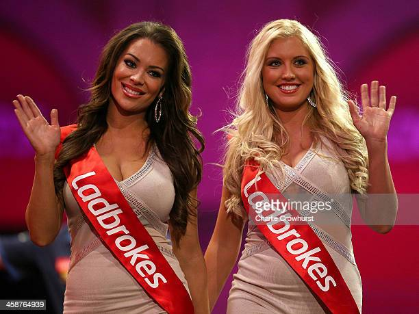 The Oche girls leave the stage and wave to the fans during the Ladbrokescom World Darts Championship on Day Nine at Alexandra Palace on December 21...
