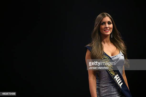 The Oche girls make their way off stage during Day Eight of the William Hill PDC World Darts Championships at Alexandra Palace on December 28 2014 in...
