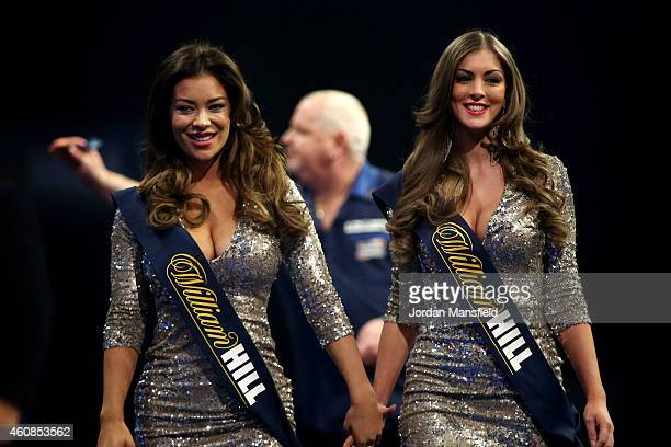 The Oche girls make their way off stage during Day Seven of the William Hill PDC World Darts Championships at Alexandra Palace on December 27 2014 in...