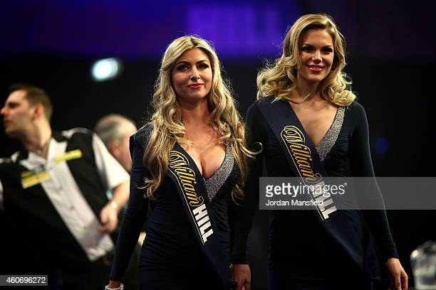 The Oche girls make their way off stage during Day Two of the William Hill PDC World Darts Championships at Alexandra Palace on December 19 2014 in...