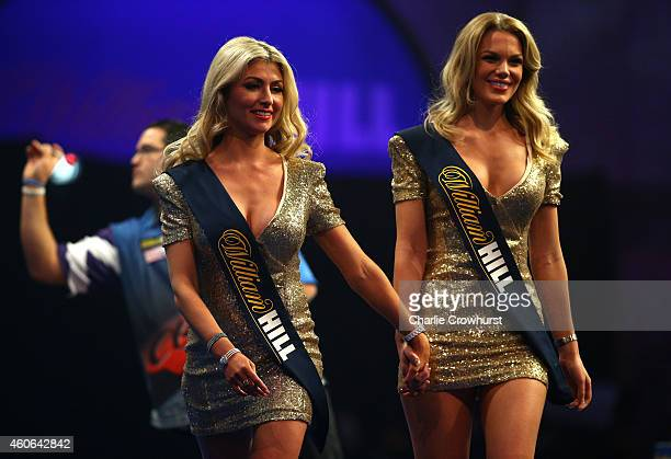 The Oche girls make their way off stage during the William Hill PDC World Darts Championships on Day One at Alexandra Palace on December 18 2014 in...