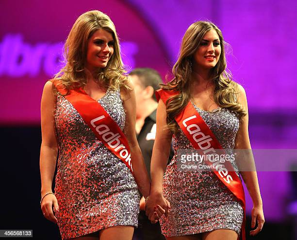 The Oche girls on stage during the Ladbrokescom World Darts Championship on Day Two at Alexandra Palace on December 14 2013 in London England