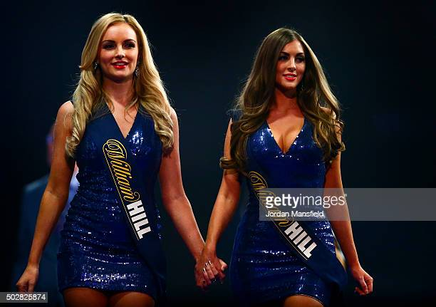 The oche girls walk off the stage on Day Eleven of the 2016 William Hill PDC World Darts Championships at Alexandra Palace on December 29 2015 in...