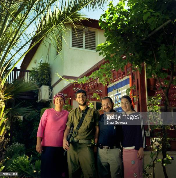 The Ochyoen family, Tzvia , Elyasaf , Yamin and Yirat Ochayen, stands for a portrait in front of their house that they have lived in for the last 20...
