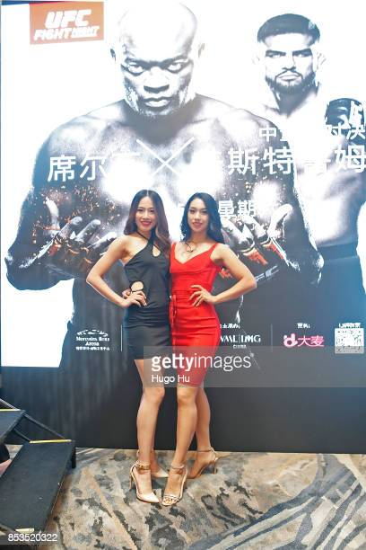 The octagon girl Pan Xiao Wang jingjing at the UFC press conference on September 25 2017 in Shanghai China
