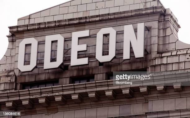 The Odeon logo is displayed outside a cinema on Leicester Square in central London UK on Monday Dec 19 2011 A site on Leicester Square in the UK...