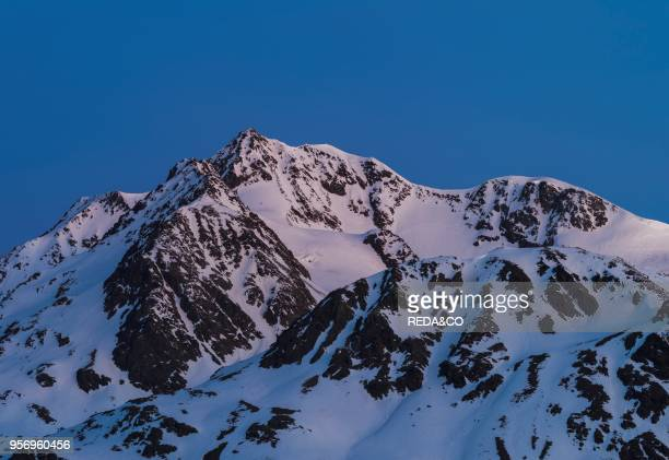 The Oetztal Alps during winter with ice and snow near Vent. Tyrol. Sunrise over Mount Wildspitze . One of the highest and most famous peaks in...