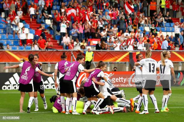The of Austria team celebrate victory after the UEFA Women's Euro 2017 Quarter Final match between Austria and Spain at Koning Willem II Stadium on...