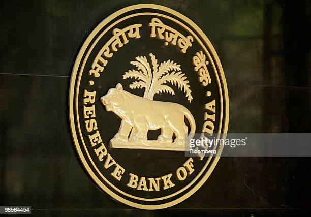 The of the Reserve Bank of India logo is displayed on the bank's building in Mumbai India on Tuesday April 20 2010 India's central bank raised...
