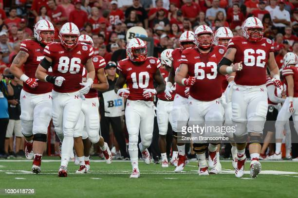 The offense for the Nebraska Cornhuskers takes the field before the first play of the game against the Akron Zips at Memorial Stadium on September 1...