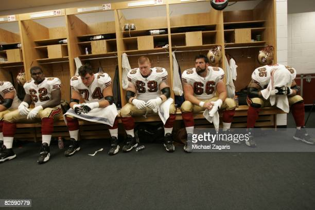 The offensive line of the San Francisco 49ers in the clubhouse before the NFL game against the Chicago Bears at Soldier Field on August 21 2008 in...