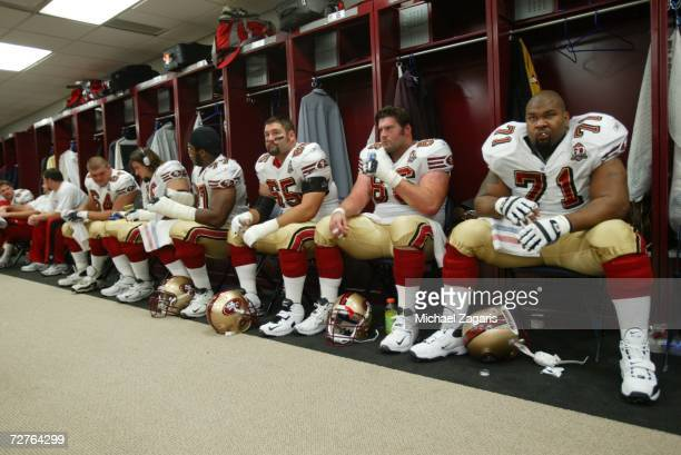 The offensive line of the San Francisco 49ers prepares in the locker room before the game against the New Orleans Saints at the Louisiana Superdome...