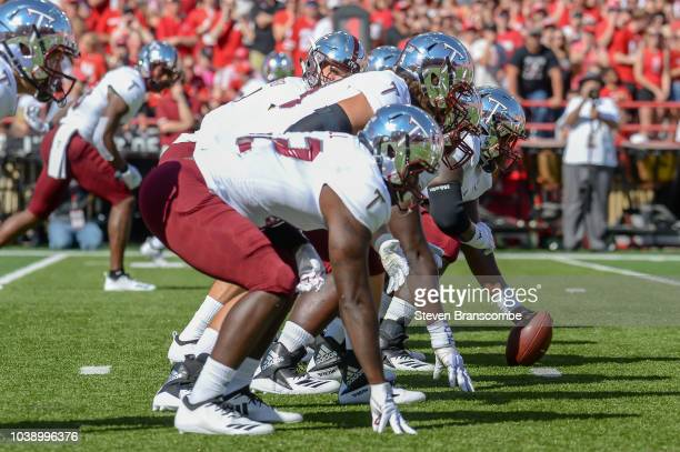 The offensive line of the Troy Trojans prepares for the opening snap against the Nebraska Cornhuskers at Memorial Stadium on September 15 2018 in...