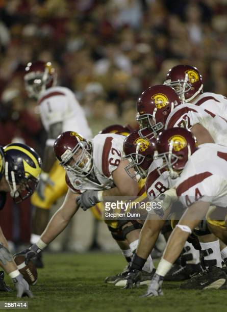 The offensive line of the USC Trojans get ready for the snap during the 2004 Rose Bowl game against the Michigan Wolverines on January 1 2004 at the...