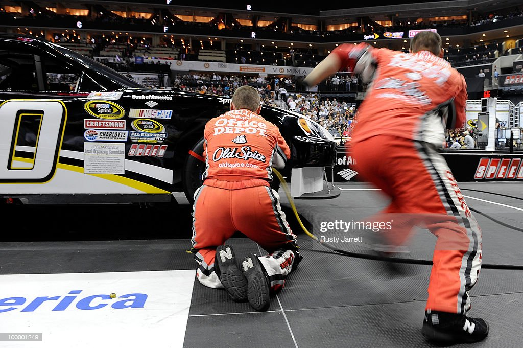 The #14 Office Depot Chevrolet pit crew race during the NASCAR Sprint Pit Crew Challenge at Time Warner Cable Arena on May 19, 2010 in Charlotte, North Carolina.