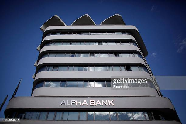 The offices of Alpha Bank AE stand in Athens Greece on Tuesday Jan 22 2013 Euroarea finance ministers blessed the next disbursement of emergency aid...