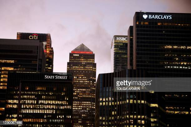 The offices of banking giants Citi, HSBC and Barclays are pictured at the the secondary central business district of Canary Wharf on the Isle of...