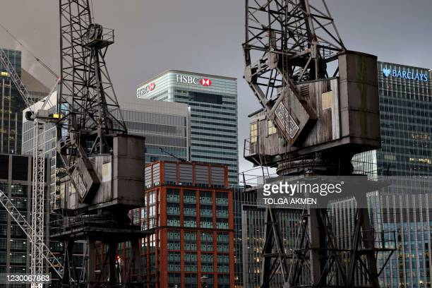 The offices of banking giants HSBC and Barclays are pictured at the the secondary central business district of Canary Wharf on the Isle of Dogs, east...