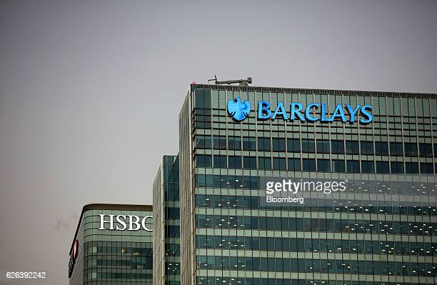 The offices of Barclays Plc right and HSBC Holdings Plc stand in the Canary Wharf business financial and shopping district of London UK on Tuesday...