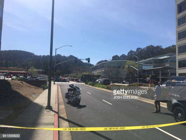 The offices of YouTube are seen in the distance outside after an active shooting at YouTube's offices in San Bruno California on April 3 2018...