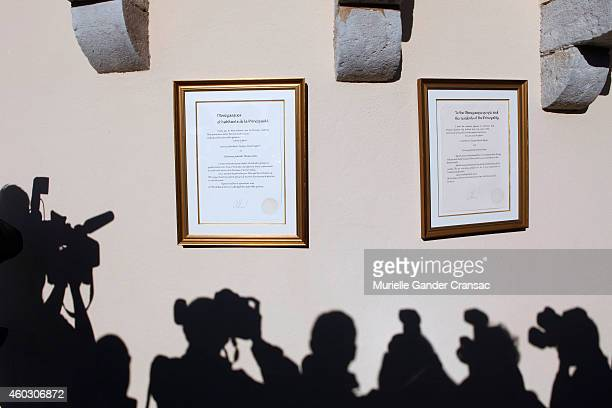 The official announcement of the birth of the royal twins Prince Jacques and Princess Gabriella hangs on the outside wall of the Monaco Palace on...
