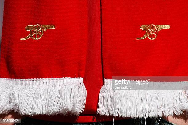 The official Arsenal crest on a fans' scarf during the FA Cup Semi Final match between Arsenal and Chelsea at Wembley Stadium in London UK