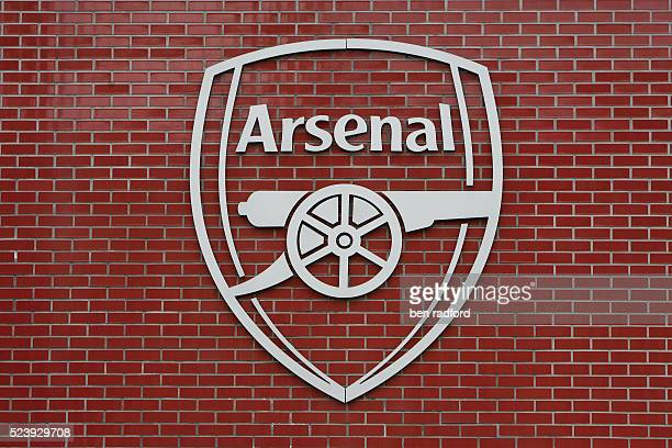 The official Arsenal logo on a wall outside the stadium during the UEFA Champions League SemiFinal 2nd Leg match between Arsenal and Manchester...