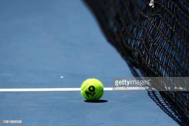 TOPSHOT The official ball is seen on a court during a practice session ahead of the Australian Open tennis tournament in Melbourne on January 13 2019...
