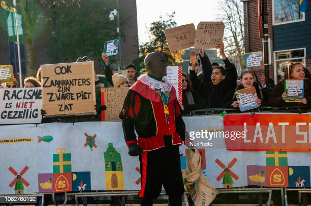 The official Black Petes passing by in front of the anti Black Pete demonstrators during the National entrance of Sinterklaas in Zaandstad...