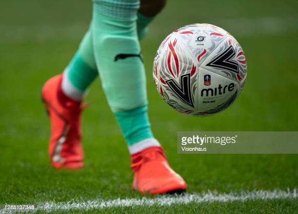 The official FA Cup match ball by Mitre during the FA Cup 1st round match between Wigan Athletic and Chorley FC at the DW Stadium on November 8, 2020...