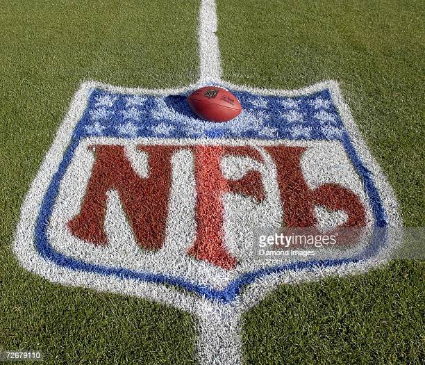 The official football for the National Football League, with the signature of new commissioner Roger Goodell, sits within the NFL logo painted on the...