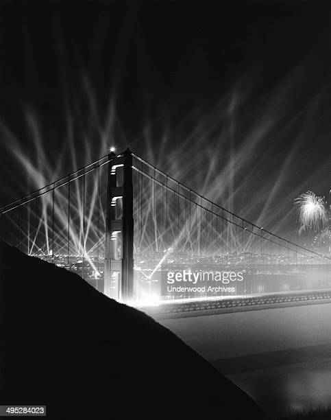 The official grand opening celebration with klieg lights and fireworks of the Golden Gate Bridge San Francisco California May 29 1937 The opening...