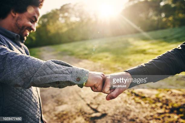 the official greeting of bros - fist bump stock pictures, royalty-free photos & images