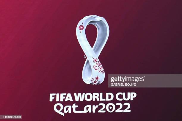The official logo of the FIFA World Cup Qatar 2022 is unveiled on a giant screen in Madrid on September 3, 2019.
