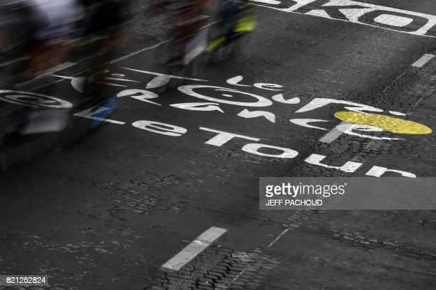 The official logo of the Tour de France is pictured on the ground during the 103 km twentyfirst and last stage of the 104th edition of the Tour de...
