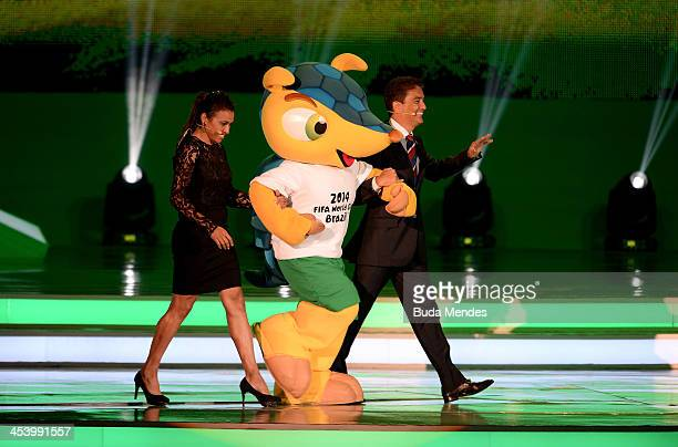 The official mascot Fuleco leaves the stage with Bebeto and Marta during the Final Draw for the 2014 FIFA World Cup Brazil at Costa do Sauipe Resort...