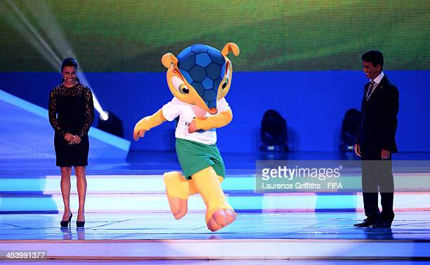 The official mascot Fuleco performs next to Bebeto and Marta during the Final Draw for the 2014 FIFA World Cup Brazil at Costa do Sauipe Resort on...