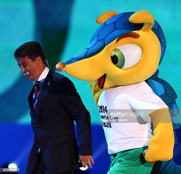 The official mascot Fuleco walks on stage next to Bebeto during the Final Draw for the 2014 FIFA World Cup Brazil at Costa do Sauipe Resort on...