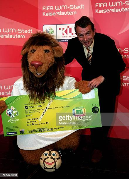 The Official Mascot of the 2006 FIFA World Cup Goleo VI and Wolfgang Niersbach head of the Organisations Committee hold an enlarged World Cup ticket...