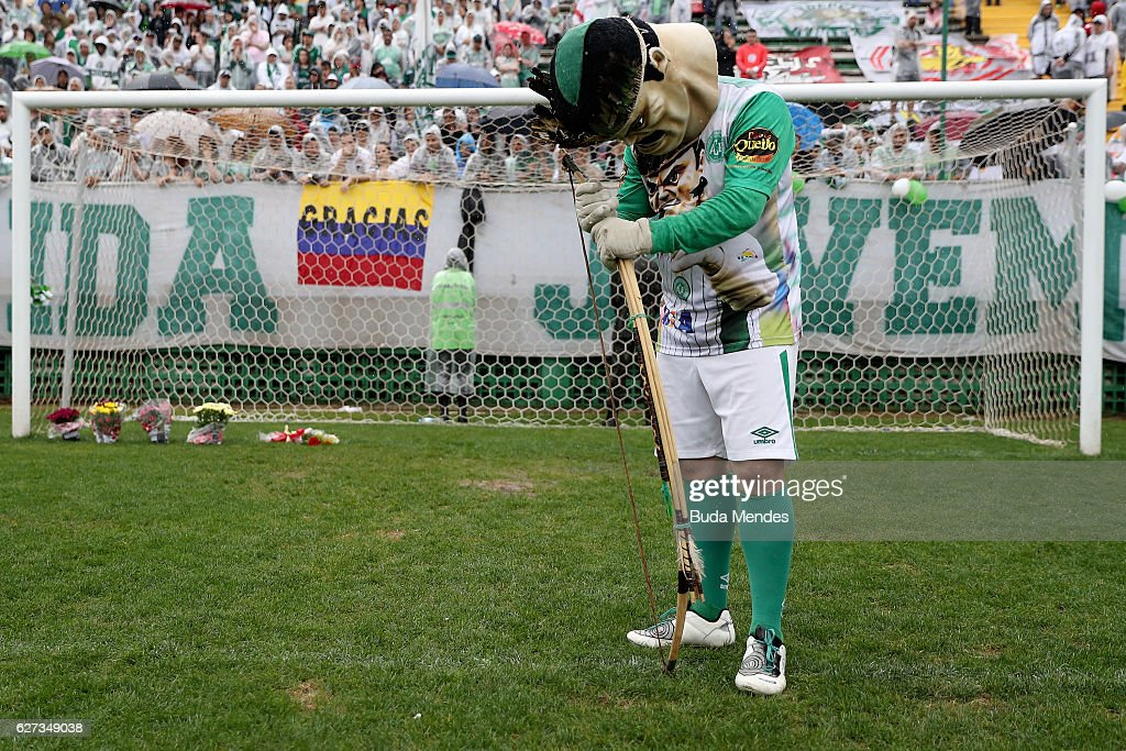 The official mascot pays tribute to the players of Brazilian team Chapecoense Real at the club's Arena Conda stadium in Chapeco, in the southern Brazilian state of Santa Catarina, on December 03, 2016. The players were killed in a plane accident in the Colombian mountains. Players of the Chapecoense team were among the 77 people on board the doomed flight that crashed into mountains in northwestern Colombia. Officials said just six people were thought to have survived, including three of the players. Chapecoense had risen from obscurity to make it to the Copa Sudamericana finals scheduled for Wednesday against Atletico Nacional of Colombia.