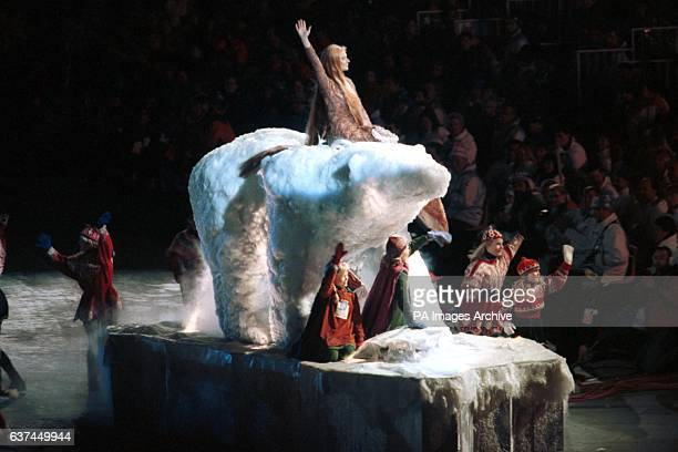 The official mascots of the Lillehammer Olympics Hakon and Kristin wave to the crowds from the front of their float which features a giant polar bear