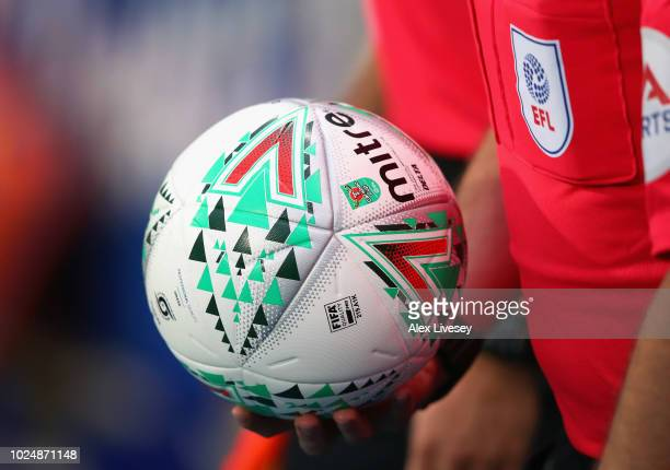 The official match ball is seen as the referee leads out the teams for the Carabao Cup Second Round match between Blackburn Rovers and Lincoln City...