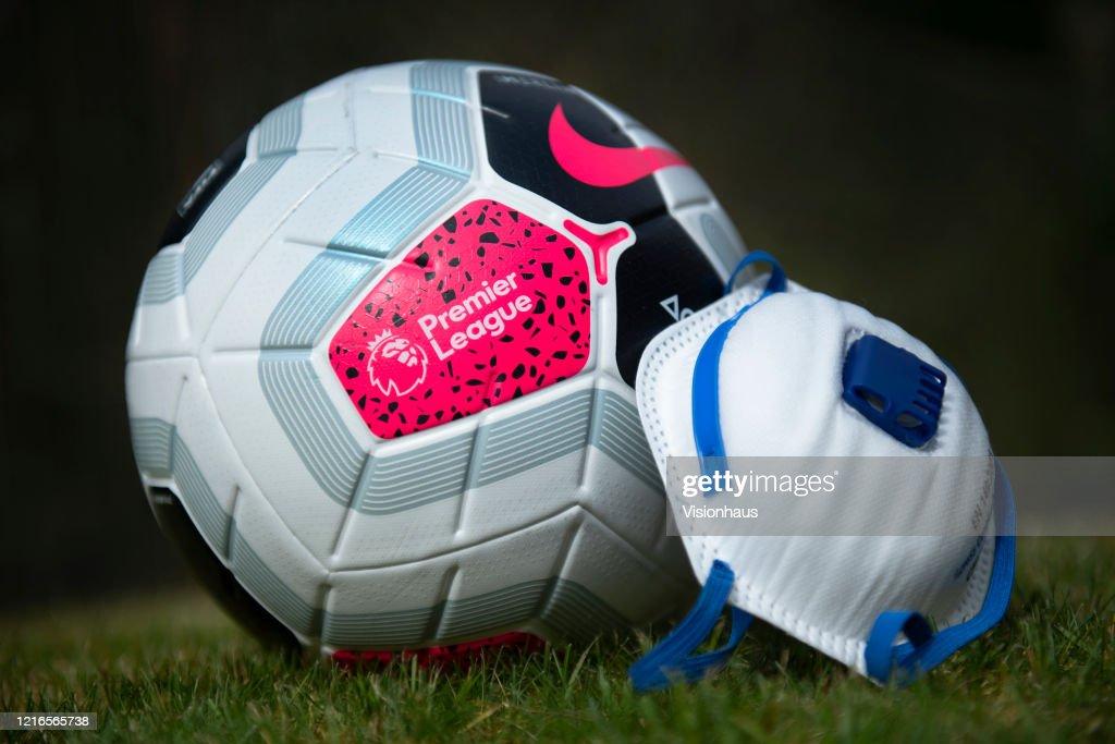 Premier League Football and Coronavirus Protective Mask : News Photo