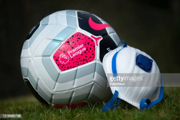 The official Nike Premier League match ball with a protective mask. The Coronavirus pandemic has spread to many countries across the world, claiming...