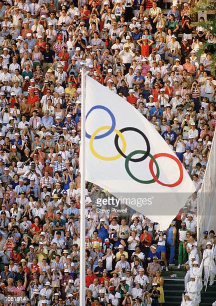 The official Olympic flag ring design created by the founder of the modern Olympic Games, Baron Pierre de Coubertin in 1912 is raised in stadium...