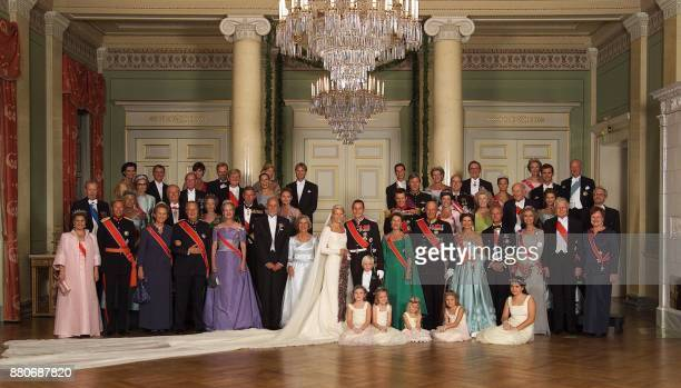 The official picture of the newlyweds and their families in the Royal Castle in Oslo late 25 August 2001. Back row from left: Kristin Hoeiby Bjornoy,...