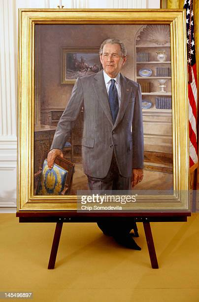 The official portrait of former US President George W Bush stands on an easel after its unveiling ceremony in the East Room of the White House May 31...