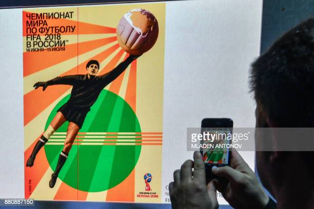 The official poster for the 2018 FIFA World Cup is displayed on a screen during a presentation at Moscow's Krasnaya Presnya metro depot on November...