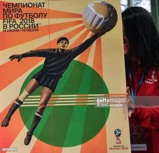 The official poster for the 2018 FIFA World Cup is pictured during a presentation at Moscow's Krasnaya Presnya metro depot on November 28 2017 / AFP...