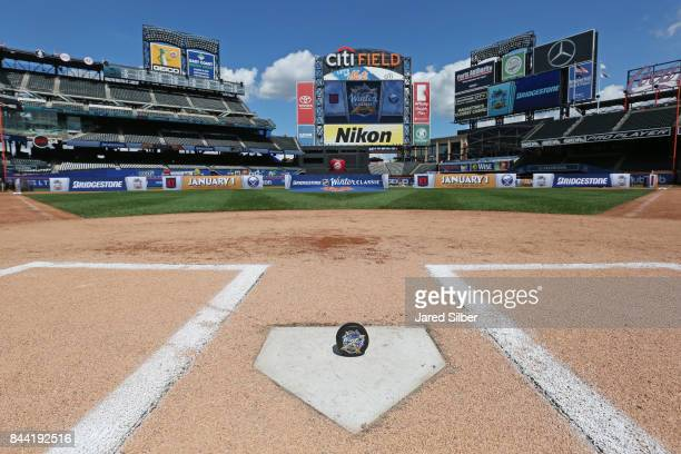 The official puck posed at home plate following the 2018 Bridgestone NHL Winter Classic Press Conference at Citi Field on September 8 2017 in Queens...